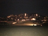 A look back at the resort at night from the beach.